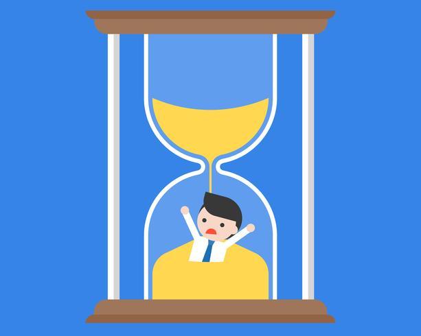 Geschäftsmann, der in der Sanduhr, Zeitmanagementkonzept überschwemmt wird