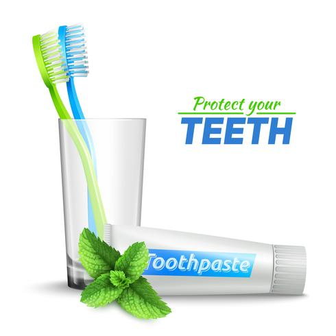 Cepillos de dientes en vidrio y pasta de dientes