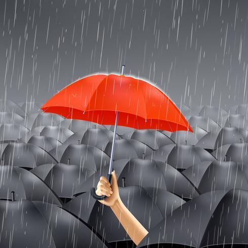 Ombrello rosso sotto la pioggia
