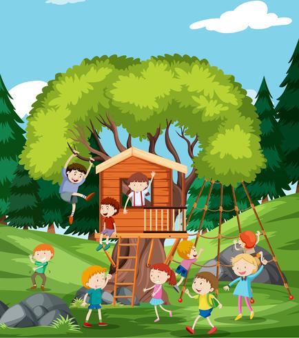 Niños jugando en la casa del árbol vector