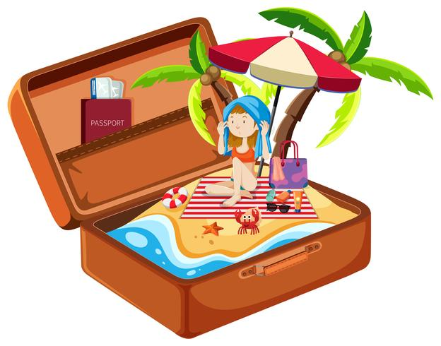 Girl on the beach in luggage