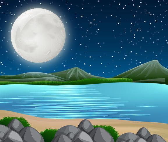 Rivierscène bij nacht