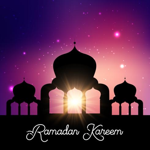 Fondo di Ramadan Kareem con la siluetta della moschea contro cielo notturno