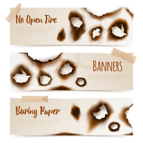 Banner di fori di carta bruciati vettore