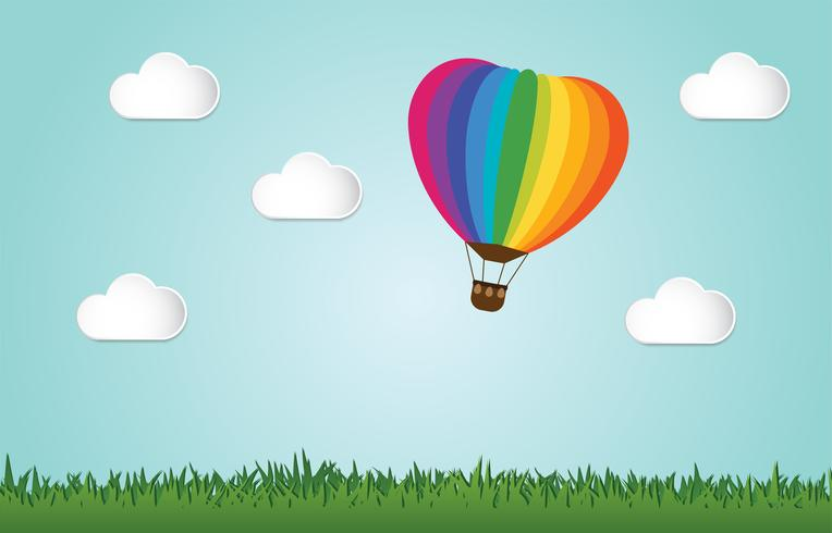 Origami gjorde färgstarkt varmluftsballongfluga över gräs.