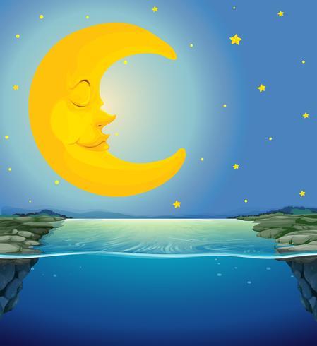 Escena nocturna con luna y estrellas sobre el río.