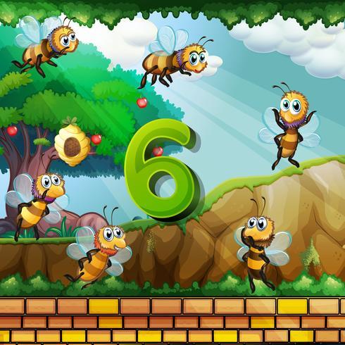 Numéro six avec 6 abeilles qui volent dans le jardin
