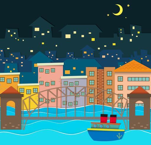 Bro över flodscenen på natten