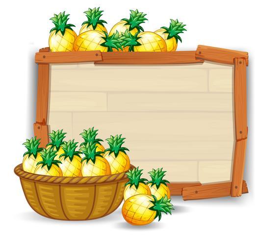 Abacaxi na placa de madeira