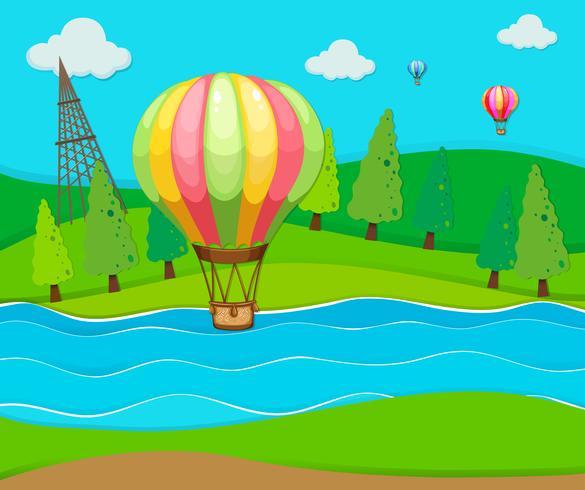 Balões voando sobre o rio