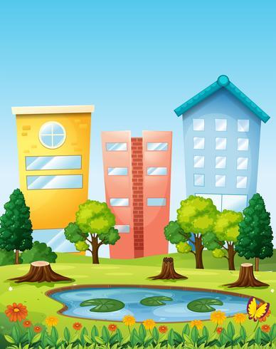Scena con tre edifici sullo stagno