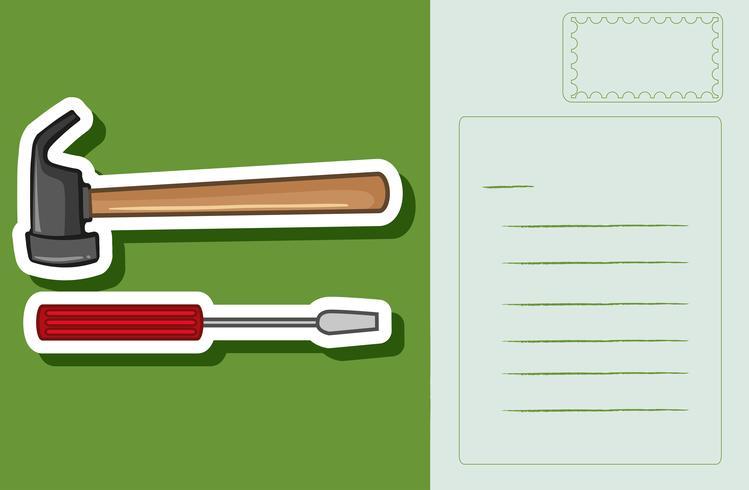 Postkartenauslegung mit Hammer und Schraubendreher
