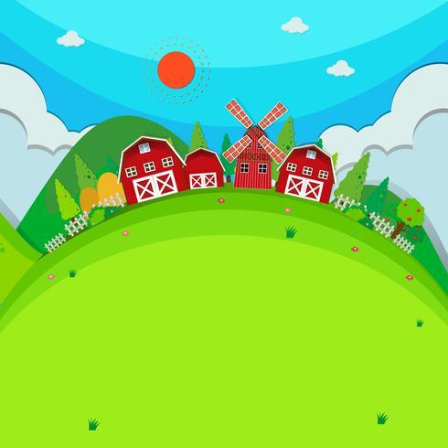 Fazenda com celeiros e moinho de vento