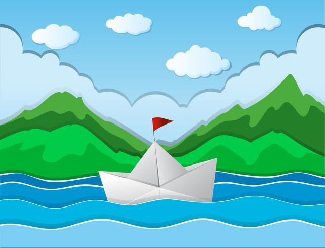 Paper boat floating along river