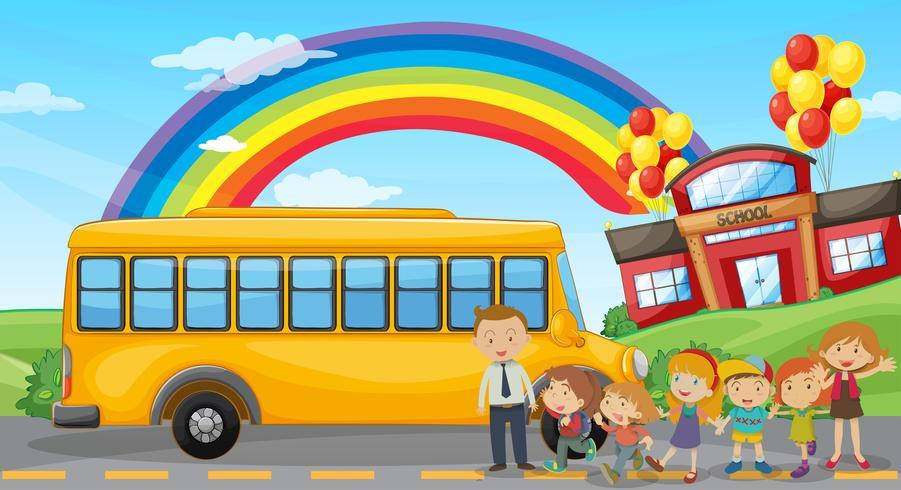 Estudiantes y autobús escolar en la escuela.