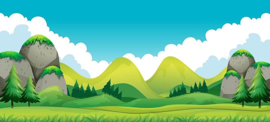 Scen av grönt fält med bergsbakgrund