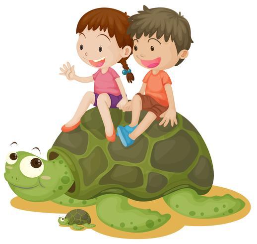 Bambini felici che guidano la tartaruga