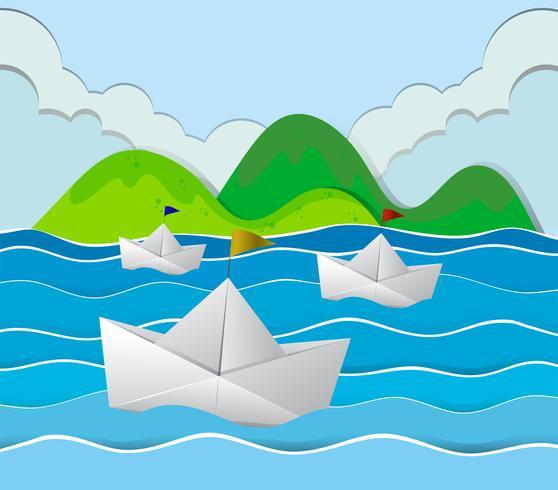 Tres barcos de papel flotando en el océano