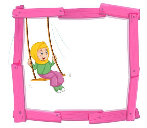 A muslim girl sin on swing frame