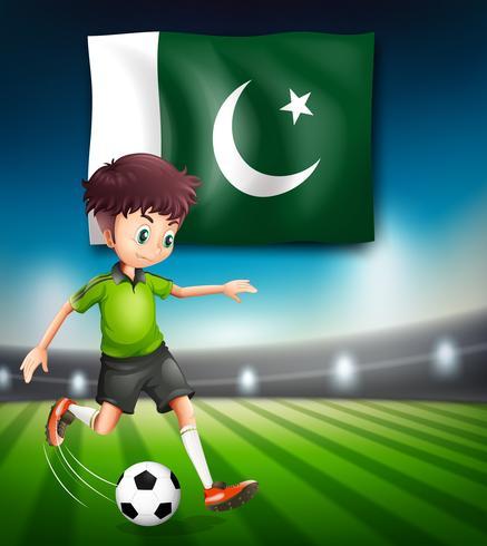 Bandera pakistaní y futbolista