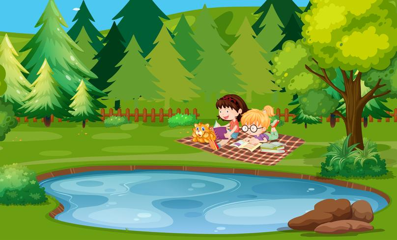 Two girls reading book by the pond