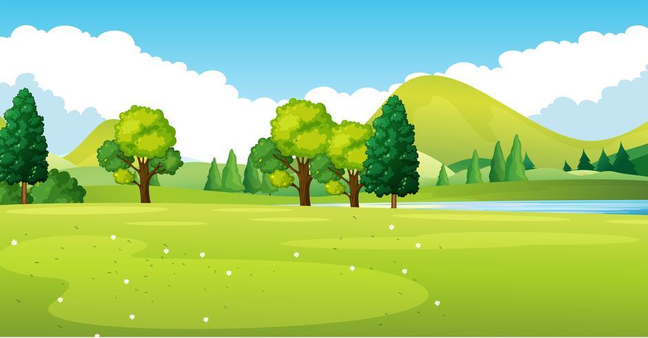 Parkszene mit grünem Feld
