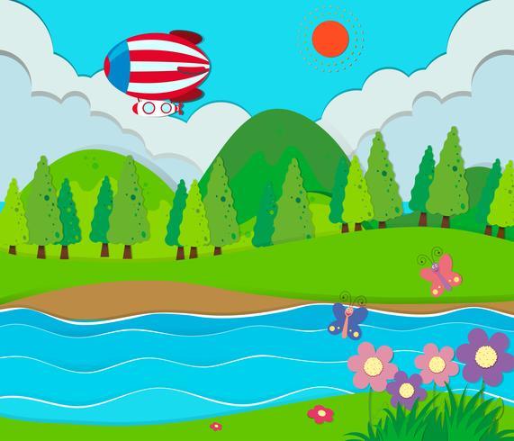Scena della natura con fiume e mongolfiera