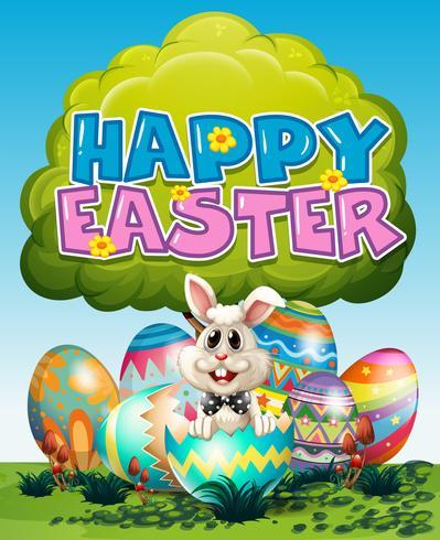 Glad påskaffisch med kanin och ägg på gräs