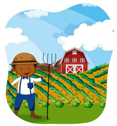 Agricultor trabajando en las tierras de cultivo.