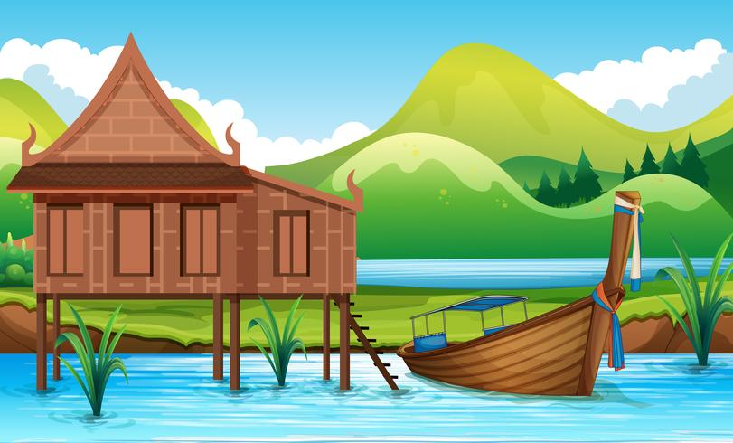Traditionelles thailändisches Haus neben dem Fluss