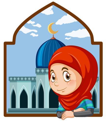 Een schattig moslimmeisje met moskee