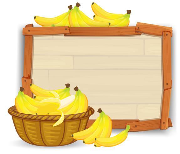 Banane dans panier sur planche de bois