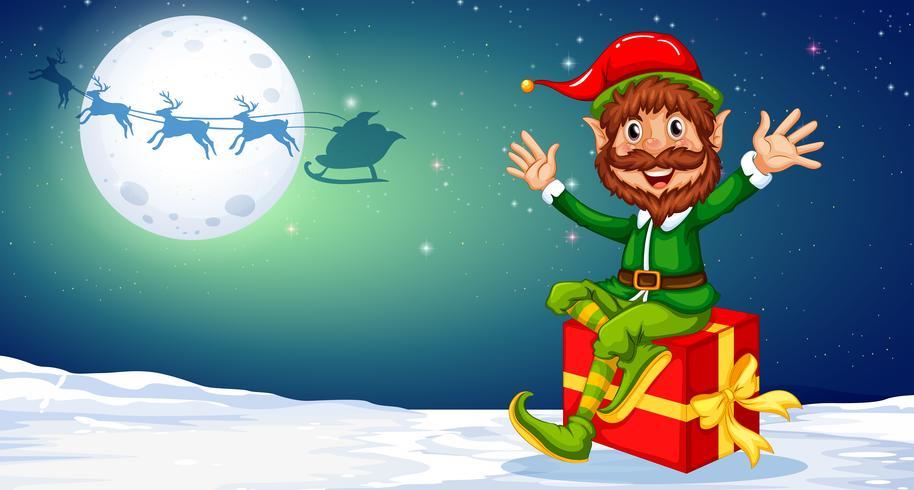 Joyeux Noël elfe assis sur un cadeau