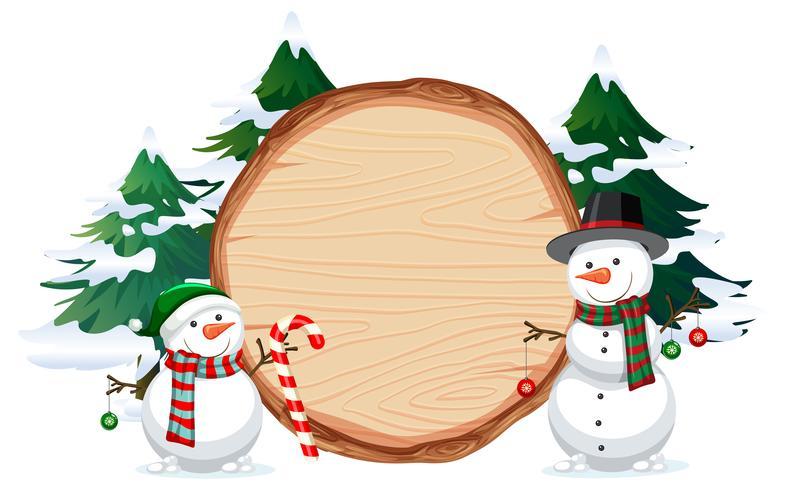Un muñeco de nieve en banner de madera
