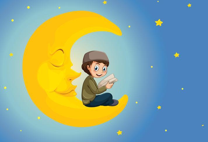 Un garçon musulman lisant sur la lune