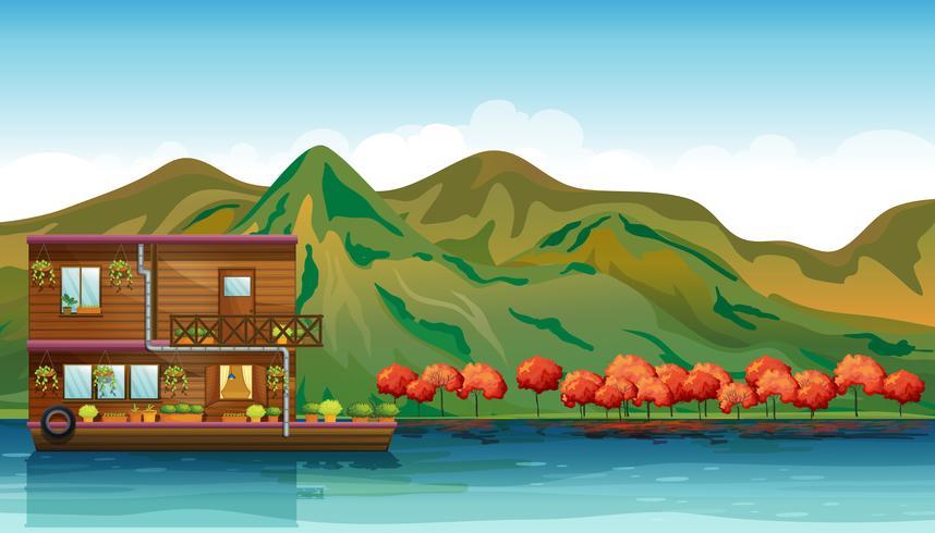 Een rivier en een botenhuis