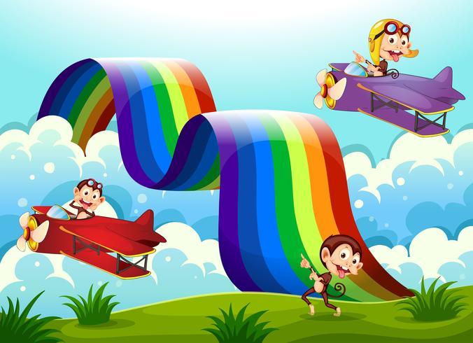 Un avión rojo y violeta con monos volando cerca del arco iris.