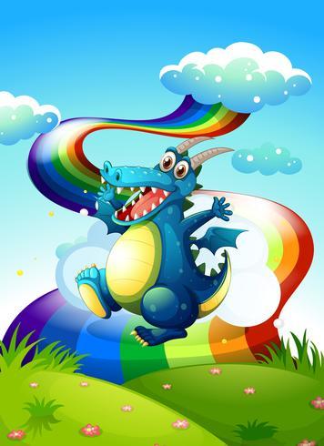 Un dragón en la cima de la colina y un arco iris en el cielo.