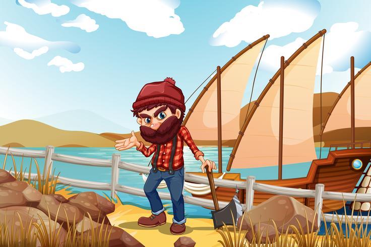 Een houthakker houdt een bijl in de buurt van de zee