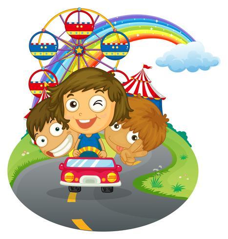 Um veículo com crianças felizes perto do parque de diversões