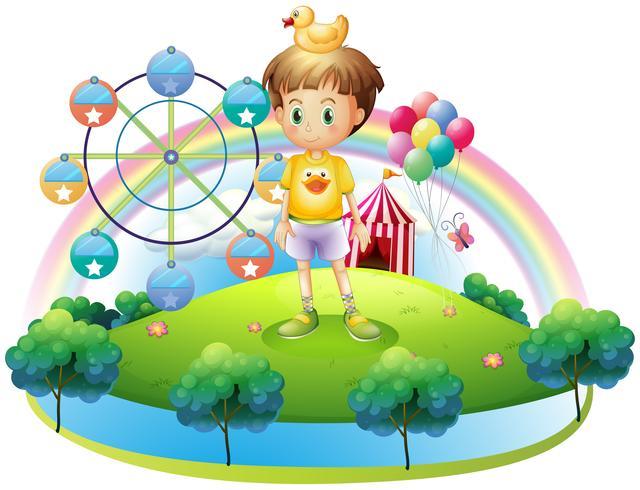 Um menino com um pato de borracha em uma ilha com um carnaval