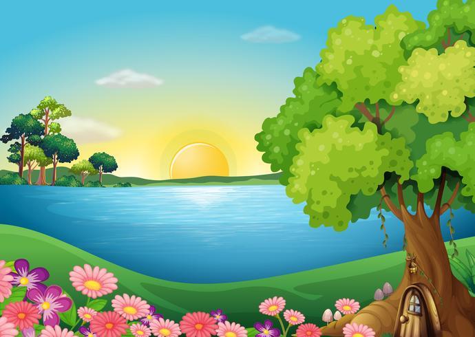 Flores frescas en la orilla del río cerca de la casa del árbol
