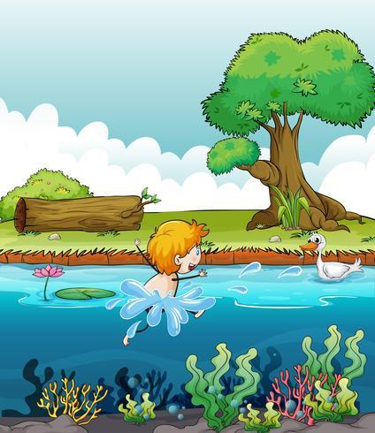 Un ragazzo che nuota con un'anatra nel fiume