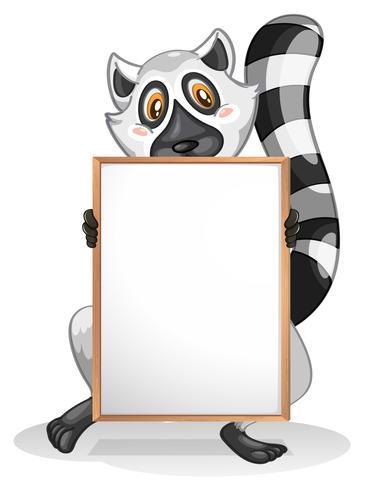 Un lémurien tenant un tableau blanc vide