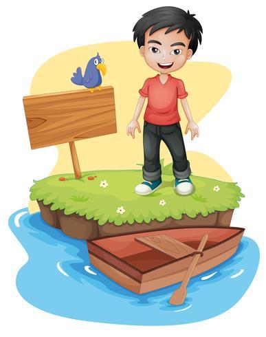 Un ragazzo vicino l'insegna vuota con un uccello