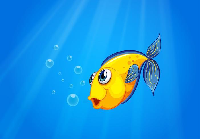 Un pez amarillo nadando bajo el mar
