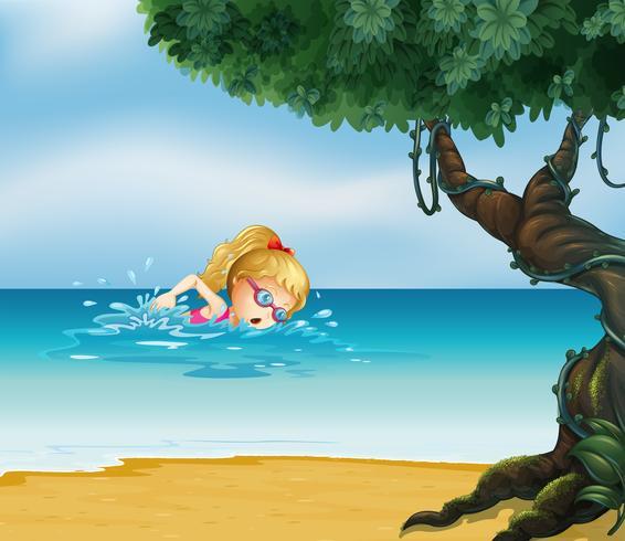 Una joven nadando en la playa.