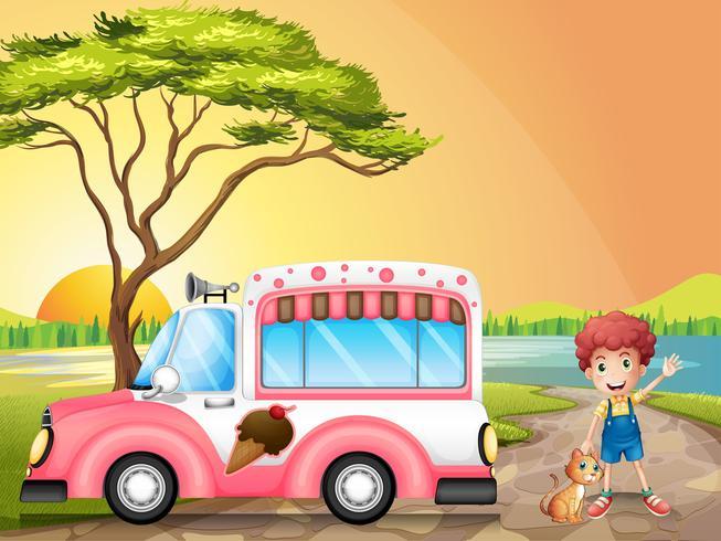 Un ragazzo con un gatto accanto a un camion di gelato