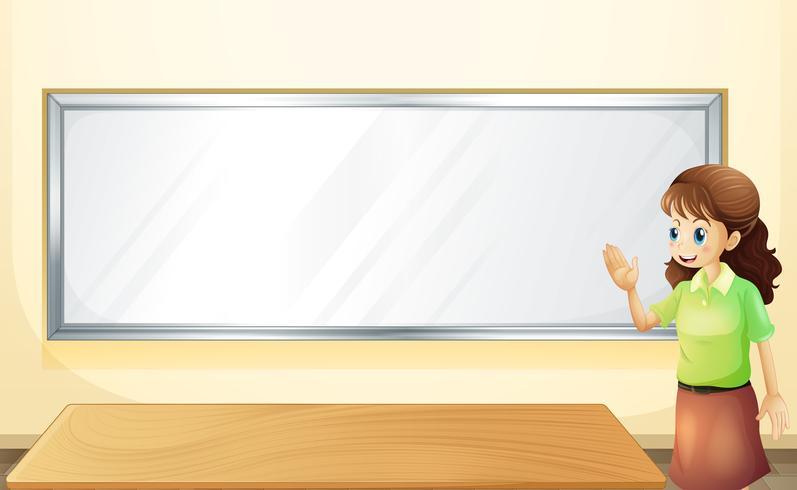 Un profesor dentro de la sala con un tablón de anuncios vacío.