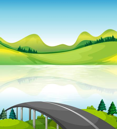 Un ponte stradale vicino al lago vettore